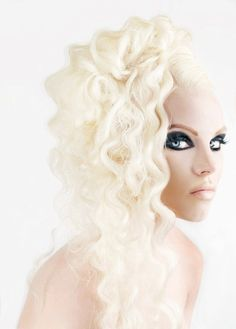 Platinum blond with loose coils.