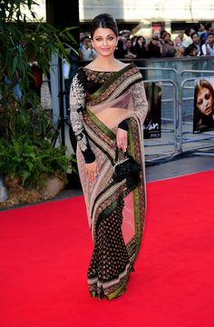 Aishwarya Rai Evening Dress. Something I would wear, if I was a friend to someone who is apart of a certain culture, who wears this style and has invited me to an event. Gorgeous saree and beautiful color combination.