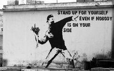 Banksy (throwing flowers)