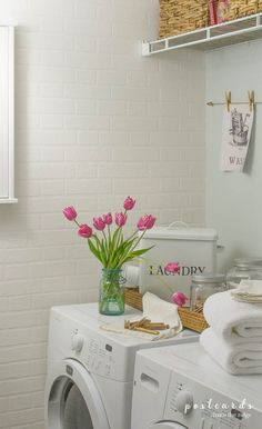 Love that brick wallpaper and all the ideas for this budget friendly small laundry room makeover.