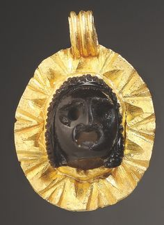 A Pendant with Theatre Mask:      Gold, agate.Roman, 2nd-3rd cent. A.D.