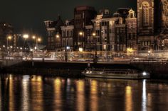 Night Reflections - City lights reflecting in a canal near Amsterdam Centraal.