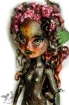 In the enchanted forest where fairies play, among the trees dryads stay! Fern has rich greens and hints of other forest colors...  Summary of treatments doll has received: *started as a Cedar Woods doll by Mattel *complete removal of original factory paint *an entirely new repainted face