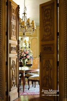 Another French style chateau designed by Leo Dowell. The house was built around the 19th century wall paneling from the Paris flea market salvaged from an old chateau. Leo found these hotel doors in a village in the south of France.