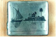Metal cigarette box from the forties showing a view from the city of Basra, donated by Mr.Naji Sahyoun, an Iraqi Jew, to the Jewish museum.