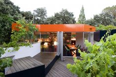 Silicon House. Orange roof + floating glass