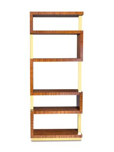 the bold rosewood and brass of this parrish etagere twist and turn for a graphic accent piece. it's a place to display art books, objects, curiosities and treasures acquired near and far.