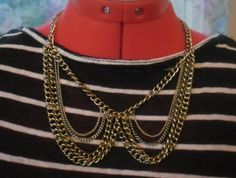 Multiple chain Peter Pan collar necklace.