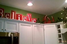 Christmas decoration above kitchen cabinets - Noel instead of believe