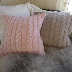 Knitted cushion with simple cable. Pattern from Mia's Landliv. must find someone to knit these for me