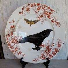 Ad this one too....just a bulbous ;) ..... Black Raven Crow Wall Plate on Orange Transferware 1800s Altered vintage china wall hanging