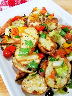 Grilled Potato Salad with peppers, tomatoes, olives and a vinaigrette dressing.