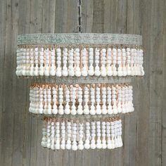 Beads are a must-have for any bohemian home. So why not go big and light it up with this beaded chandelier.