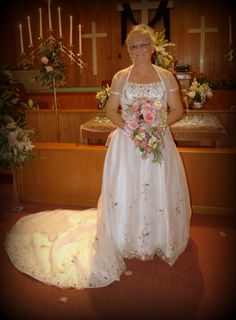 Beautiful bride with fresh cut cascade bouquet.