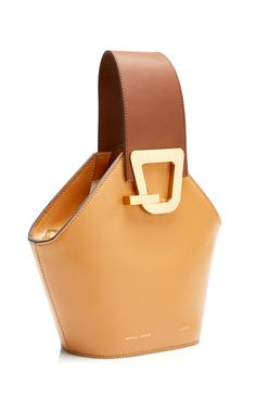 Love this color and the uniqueness of this bag!