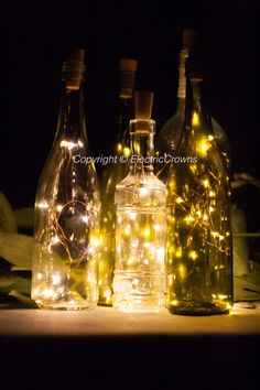 wine lighting. wine bottle lights table decor by electriccrowns lighting