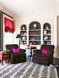 graphic statement: white arched built ins with deep chocolate brown backs & high contrast rug - love the bookcases, chairs and window treatment. Rug - not so much! Spacious Living Room, Living Spaces, Living Rooms, Furniture Styles, Furniture Design, Painted Furniture, Oak Panels, Moldings And Trim, Moulding