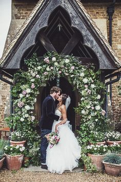 Floral Arch on Church - Rustic Glam Tipi Wedding With Pink Peony Bouquet & Bride In Leather Jacket Planned by Gordon Malone Images From Claire Penn Photography