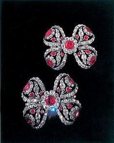 THE ROMANOVS JEWELRY ~ A pair of bows to decorate sleeves made for Catherine II of Russia.  Between 1765-1767. 4.2х4.9 sm. Gold, silver, diamonds, rubies, shpinel (the same gem is on the top of grand Imperial crown of Russia).