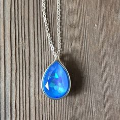 Petite teardrop necklace with Swarovski crystal Absolutely gorgeous petite teardrop genuine Swarovski fancy stone crystal in a silver setting in ultra blue. Last pix shows approximate size. Crystal is 18mmx13mm pear or teardrop shape silver setting. Hubby & I make our jewelry using genuine Swarovski crystals.  All items are brand-new and much prettier in person than pictures.  Proceeds used to help our 5-yr-old granddaughter Lila May in her fight against cancer, but she lost her battle…