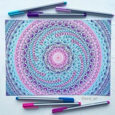 Love the teal, pink, purple and blue of this mandala design, so bright! Use colored pencils from Aurora art supplies! http://aurora-artsupplies.com