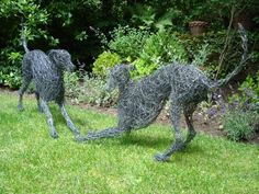 Painted galvinised steel wire #sculpture by #sculptor Emma Walker titled: '`young whippet playing` 2 study wire'. #EmmaWalker
