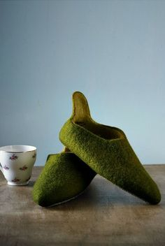 Fair Trade felt slippers from http://www.piece-makers.co.nz/stalls/browse-stalls/piece-ltd/dark-olive-felt-pixie-slippers/