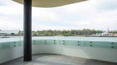 Modern looking curved balustrade. Curved Glass, Facade, Concrete, Modern, Design, Trendy Tree, Facades