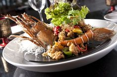 Phuket lobster cooked in garlic and pepper at Talung Thai restaurant at Paresa Restort. An exquisite dish with an exceptional view!