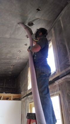 Here I'm blowing cellulose into the vaulted ceiling, supported by fabric.