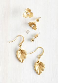 Earrings with this much variety are sure to leave you with joyous thoughts in mind. This matte gold set features dangling leaves, floral posts, and rhinestone studs, offering you plenty of opportunities to create memorable looks.