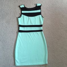 Dress Never worn, without tags. Mint green and see through mess black dress. Perfect for going out! Wet Seal Dresses Mini