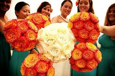 She DIYed all the bouquets for her wedding using bi-colored circus roses for the bridesmaids, and a combination of white regular and garden roses for her own bouquet.
