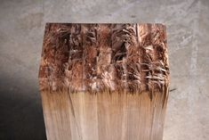 This table/bench is constructed from known hardware store materials smashed and reconstituted. Its fractures are repaired with polyester resin. The applied repair itself discolors and ruptures a thousand fold in reaction to moisture in the wood.               BROKEN WOOD TABLE by Jack Craig