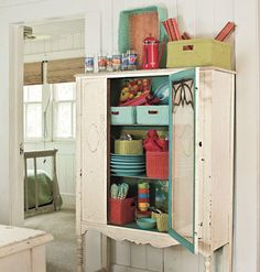 Outdoor Party Pantry- Hutch Cabinet filled with plastic plates, cups, etc.