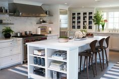 Sage design kitchen bookshelves on lower island for cookbooks