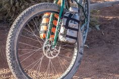 There's a growing list of cargo cages, fork mounted bags, and Anything bags. Here's our complete Gear Index of options. King Cage, Nalgene Bottle, Mountain Bike Tour, Insulated Bags, Bike Packing, Fork, Panniers, Biking, Bicycles