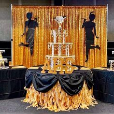Elegant 1920's Art Deco Great Gatsby themed champagne tower and cake table decorations from CV Linens. Click to shop our affordable wholesale wedding and party linens on a budget. Black and gold wedding cake table decorations. Event by @yordans_decorations Great Gatsby Wedding, Gold Wedding Theme, Gatsby Party, Wedding Colors, Wedding Cake Table Decorations, Wedding Cakes, Champagne Tower, Sequin Tablecloth, Curly Willow