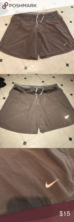 Nike running shorts size small Drawstring says Nike running. 2 pockets on each side and 2 hidden pockets inside. Built in underwear. Tan color not sure how to describe it but the 6th picture shows it's true color best. Nike Shorts