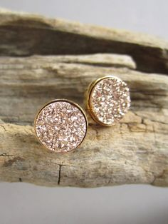 Gorgeous, rose gold colored druzy quartz coins are bezel set in gold vermeil ear posts with backs. Natural, druzy stones are vapor coated with