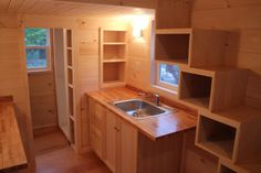 A 160 square feet tiny house on wheels with storage stairs in Londonderry, Vermont.