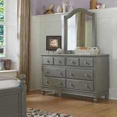 The Lake House 8-drawer dresser is crafted from poplar solids and veneers in a beautiful stone grey finish. The classic silhouette with complement your traditional bedroom decor and English dovetail c                                                                                                                                                                                 More