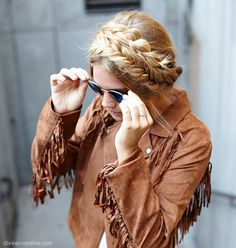 Keep your hair off your neck and out of your face with this mixed milkmaid braid. Toss on a suede-fringe jacket to capture that ever-so-popular 70s trend.