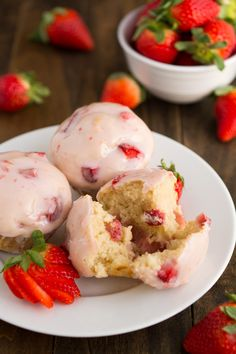 Glazed Strawberry Muffins- Soft and tender muffins filled with fresh strawberries and dipped in a sweet strawberry glaze.