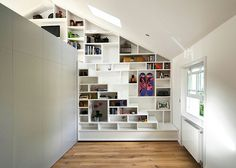 Built in shelves. I think I would make one or two of the openings into windows Tiny House Movement // Tiny Living // Tiny House on Wheels // Tiny House Stairs // Tiny Home Shelves // Tiny Home Loft Design, Deco Design, House Design, Attic Design, Design Design, Tiny Spaces, Loft Spaces, Loft Apartments, Escalier Design
