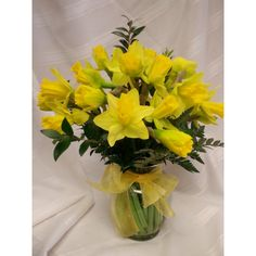 Nothing says spring like daffodils. Vase of cheerful daffodils