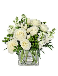 Beautiful winter flower arrangement with cedar, holly, white roses, white stock, and green hypericum #winterflowers #whiteflowers