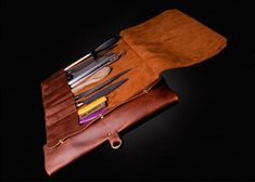 handmade leather knife roll by OLDSALTSLEATHERWORKS on Etsy