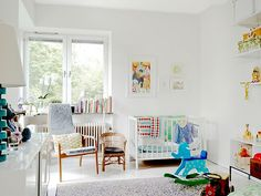 white nursery with great pops of color