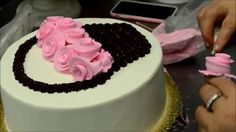 Decorating a Rose basket made from whipped cream frosting the flavor of the cake is chocolate cake with cream cheese filling this design is perfect for someb...
